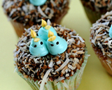 Cupcakes decorated to look like a nest with baby bluebirds