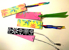 An assortment of bookmarks made from note cards