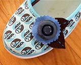 Shoe embellishment made from button and felt