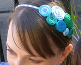 Headband embellished with coiled t-shirt strips