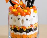 Marshmallow Peeps and candy corns make a cute Halloween centerpiece