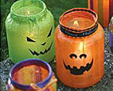 Decoupage glass jars to make jack o' lanterns