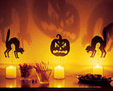 Cutout paper and candles create spooky shadows